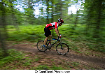 Mountain Biker with blurred background - Mountain Biker...