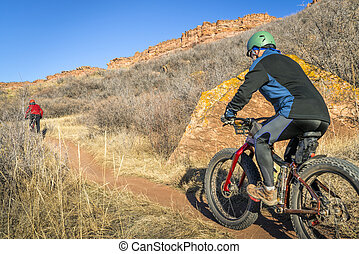 mountain bikers riding trail at Colorado foothills