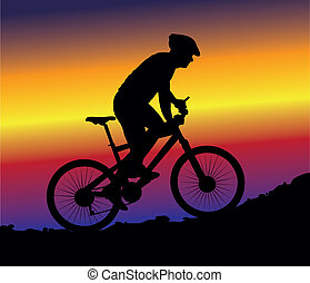 off-road cycling, cyclist on the background of sunset sky