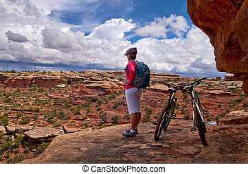Mountain Biker Girl looking down from Elephant Hill Canyonlands