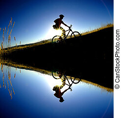 Mountain Biking - Mountain biking up a trail in the...