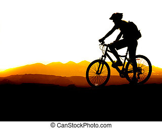 Mountain Biking - Mountain biking up a trail in the ...