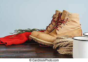 Mountain boots and hiking gear on wooden planks