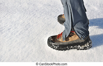 mountain boots in snow