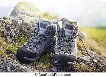 Mountain boots on the cliff