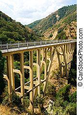 Mountain bridge over the river