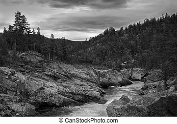 Mountain brook black and white dramatic landscape.