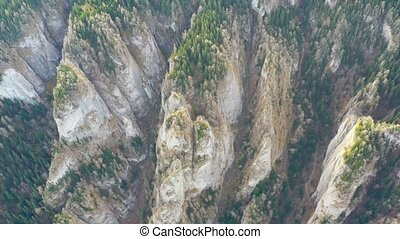 Mountain canyon in summer forest, huge rocks from above,...