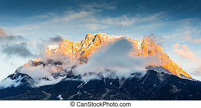 mountain chain wetterstein in tirol with lighted summit at sunset