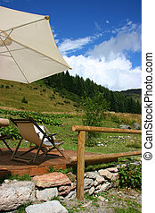 Mountain, chairs and umbrella