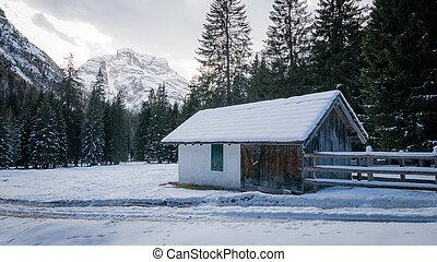 Mountain chalet in snowy alpine valley