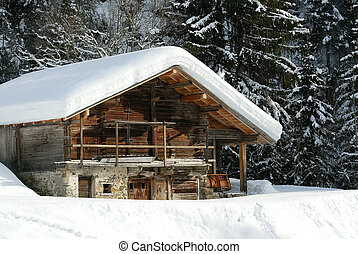 mountain chalet under the snow