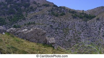 Mountain Cliffs Rock Formations Aerial Camera Fly along...
