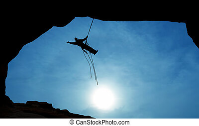 Mountain Climber Silhouette with copy space
