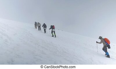 Mountain climbers make an ascent to the summit of Elbrus. In...