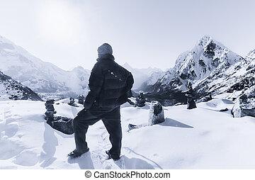 Mountain climbing: Alpinist on the peak in the Himalaya...