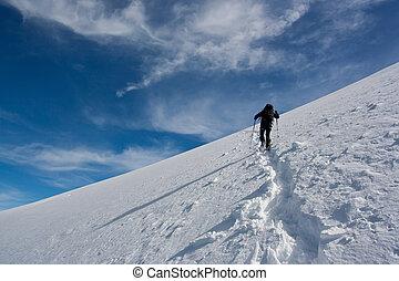 Mountain climbing - Climber ascending snowy peak