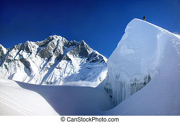 Extreme mountain climbing with Lhotse in the background in the Himalayas, Asia