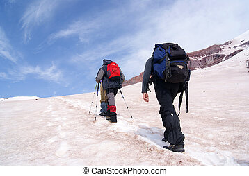 Mountain climbing - Two climbers are moving to the top of...
