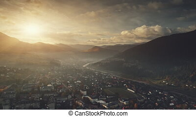 Mountain dawn suburban cottage town aerial view - Mountain...