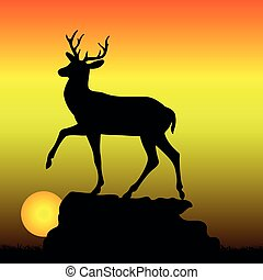 Mountain deer on top of a hill, silhouette on a sunrise background,
