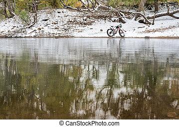 mountain fat bike on a lake shore