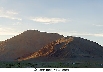 Mountain high camp at sunset