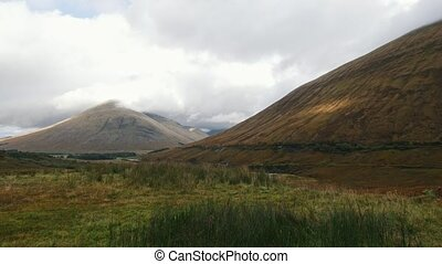 Mountain highlands in Scotland - time-lapse, wide angle