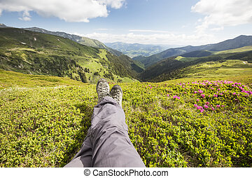 Hiker feet resting on top of the hill
