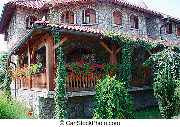 mountain house with flowers