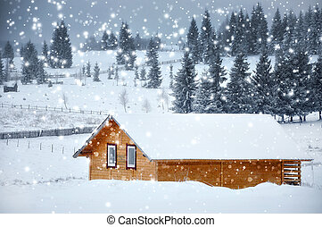 Mountain hut in winter with snowflakes. Christmas concept