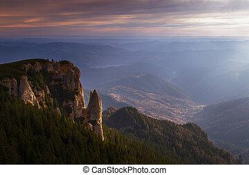Mountain illuminated by sunlight