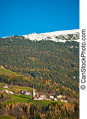 mountain in winter with green woods i and the first snow on the highest peaks