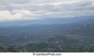 Mountain Komovi in Montenegro. Fog is falling on mountain as...