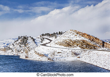 mountain lake and road in winter