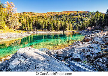 Mountain lake at sunny day. Alps, Austria, Tyrol, Lake Obernberg, Stubai Alps.