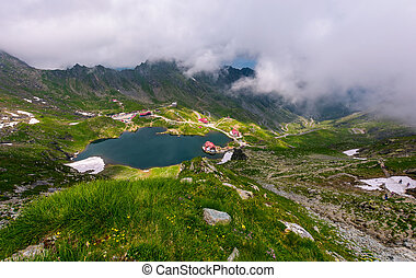 mountain lake Balea view through the clouds. amazing summer...