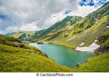 Mountain lake. Beautiful sky with clouds. Wonderful valley. Hiking and Tourism Concept. hdr