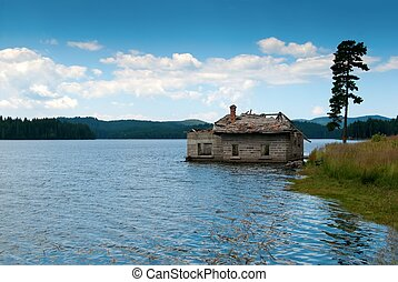mountain lake flood house