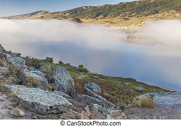 mountain lake in a fog