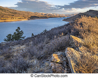 mountain lake in at Colorado foothills -  Horsetooth Reservoir, popular recreation destination for boating, hiking and biking in northern Colorado, fall scenery at sunrise