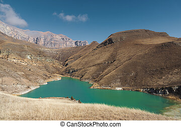 Mountain lake in the Caucasus on the background of epic rocks