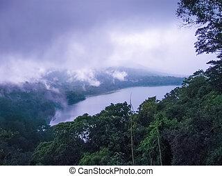 Mountain lake in the clouds. Bratan lake, Bali Indonesia