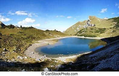 Mountain lake in Tyrol, Austria - The Tannheim Mountains in...