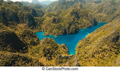 Mountain lake Kayangan on a tropical island, Philippines,...