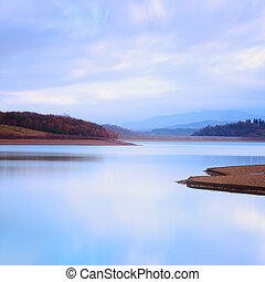 Mountain lake landscape in a cold atmosphere. - A mountain...