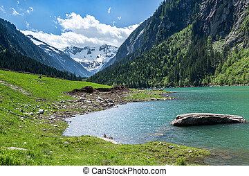 Mountain lake landscape in the Alps, Austria, Tyrol, Stilluptal Lake, Zillertal Alps Nature Park