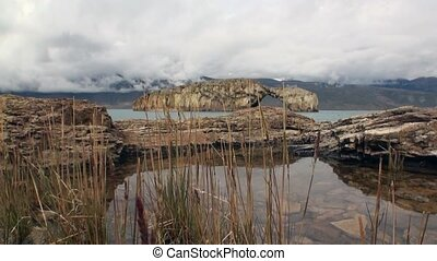 Mountain lake on background of low clouds in Patagonia Argentina.