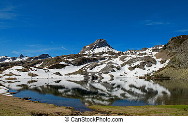 Mountain lake reflection in the french Pyrenees