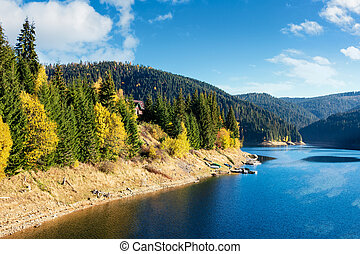 mountain lake reservoir in autumn
